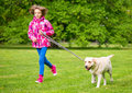 Girl with labrador retriever dog Royalty Free Stock Photo