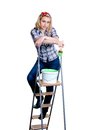Girl on ladder with paint Royalty Free Stock Photo