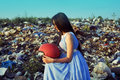 The girl in a landfill with a helmet