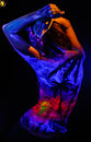 Girl with landscape bodyart in blacklight Royalty Free Stock Photo
