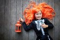 Girl with lantern portrait of cute in red wig looking at camera smile Royalty Free Stock Photo