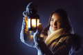 Girl with lantern seeking in night beautiful Royalty Free Stock Photography