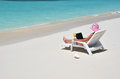 Girl with a laptop on the beach exuma bahamas tropical Royalty Free Stock Images