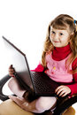 Girl with laptop in chair Stock Photography