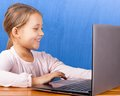Girl with laptop cheerful little Royalty Free Stock Images