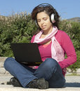 Girl with a laptop and headphones Royalty Free Stock Images