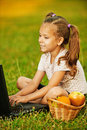 Girl laptop little working Royaltyfria Bilder