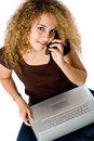 Girl On Laptop and phone Stock Photo