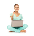 Girl with laptop showing thumbs up young sitting on the floor Royalty Free Stock Images