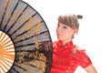 Girl with a large oriental fan in red dress Stock Images