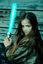Girl with laser sword Royalty Free Stock Photo