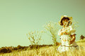 Girl in the late summer walking through a field of flowers and w Royalty Free Stock Photo