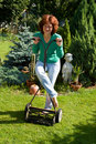 Girl with lawn mower Royalty Free Stock Images