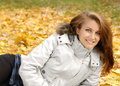 Girl laying in autumn park Stock Image