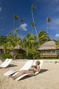 Girl laying on a beach in Moorea Stock Image