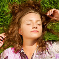 The girl lays on a grass Royalty Free Stock Photo