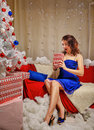Girl lays out gifts near a Christmas tree. Royalty Free Stock Photo