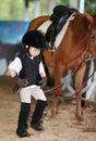 Girl leading a horse Stock Photos