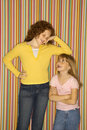 Girl leaning on smaller girl. Royalty Free Stock Image