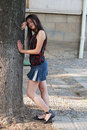 Girl leaning on tree Stock Photos