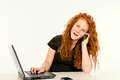 Girl is learning with the computer and calling red hair Royalty Free Stock Photo