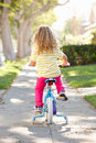 Girl Learning To Ride Bike On Path Royalty Free Stock Photo