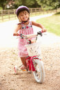 Girl Learning To Ride Bike Wearing Safety Helmet Stock Photos
