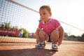 Girl learning to tie shoelaces little outside Royalty Free Stock Image