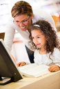 Girl learning to use technology Royalty Free Stock Photography