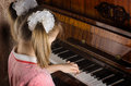 The girl learns to play a piano hands of who Royalty Free Stock Photo