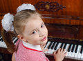 The girl learns to play a piano hands of who Royalty Free Stock Photography