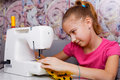 Girl learns to sew Royalty Free Stock Photo