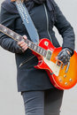 Girl leather gloves playing electric guitar Royalty Free Stock Photos