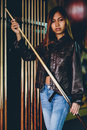 Girl in leather jacket preparing to play billiard Royalty Free Stock Photo