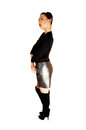 Girl in leather skirt a tall and slim young chinese woman a black top and jacket with a gray and long black boots standing for Royalty Free Stock Photography