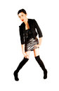 Girl in leather skirt a tall and slim young chinese woman a black top and jacket with a gray and long black boots standing for Stock Photography