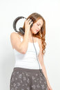 Girl leisurely listens to audio headphones Stock Images