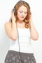 Girl leisurely listens to audio headsets Stock Photo