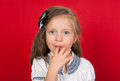 Girl licking her fingers on red background Royalty Free Stock Photos