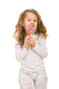 Girl licking a tasty lollipop Royalty Free Stock Photo