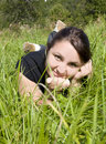 Girl lie on a grass Stock Photos