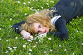 Girl lie on the grass Royalty Free Stock Image