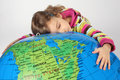 Girl lies on big inflatable globe and embracing it