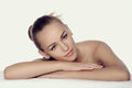 Girl lies on a towel in a spa. She looks very pleased and relaxe Royalty Free Stock Photo