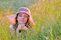 Girl lies among the wild flowers Stock Photography