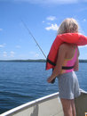 Girl with life jacket fishing Royalty Free Stock Image