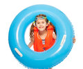 A girl in lifejacket and goggles with rubber ring Royalty Free Stock Photo