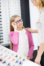 Girl like blue framework for glasses Royalty Free Stock Photo