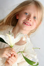 Girl and lilies Royalty Free Stock Images