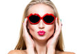Girl in lips shaped sunglasses close up portrait of beautiful young with red wearing Royalty Free Stock Photo